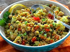 Healthy, colorful quinoa salad with chickpeas, veggies, lemon and mint. added curried chickpea dressing from Michael smith