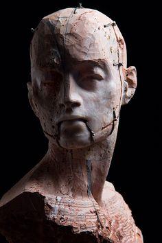 Christian Zucconi (1978, Italy), TESTA III (2014), Stone, iron and wax / Pietra, ferro e cera, cm 28 x 21 x 40; cm 30 x 20,5 x 41.