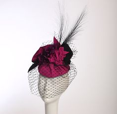 Daring  Fuscia pleated fur velour with thai silk, black French veiling and purple silk flowers. $525