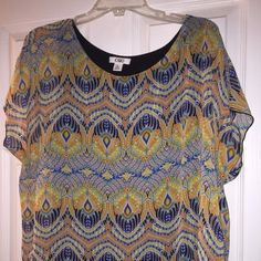 Cato blouse This blouse has a built in black cami with a sheer colorful loose fitting slightly crop top over it. XL Cato Tops Blouses