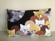 "I call this pillow ""Moonlight Kitties"". It's an adaptattion to a clamshell quilt that I found somewhere on the internet."