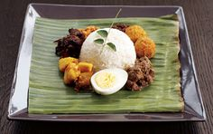 Sri Lankan Lamprice recipe...lots of recipes in this including eggplant moju, yellow rice, cutlets, meat curry, fried ash plantain curry and seeni sambol