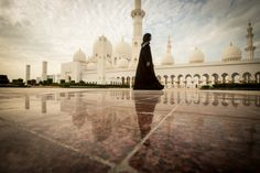 """""""Beauty at Sheikh Zayed Grand Mosque"""" The Sheikh Zayed Grand Mosque in Abu Dhabi, United Arab Emirates, is (of course) a religious shrine and not a fairytale fabrication. The pure white-on-white structure is an astonishing architectural treasure, a tranquil site that seems too beautiful to be real. I foresee it earning iconic status, like Notre Dame or the Taj Mahal. Perhaps it will replace one of the 7 New Wonders of the World when it becomes more widely recognized."""