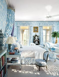 A Manuel Canovas fabric swathes the master bedroom of Patricia Altschul's spectacular 1850s South Carolina mansion, which was decorated by Mario Buatta. A Donald Roller Wilson painting is displayed above a 19th-century chinoiserie étagère from Philip Colleck.