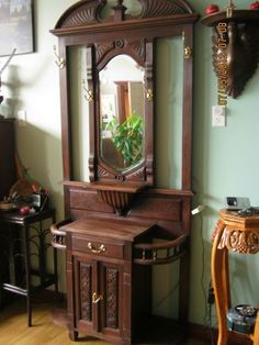 Antique Entryway Table found on estatesales: antique hall tree with storage under the