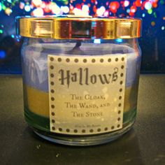 Deathly Hallows Scented 4 oz Candle:  Cloak, Wand, and Stone with Suprise INSIDE! - Thumbnail 1