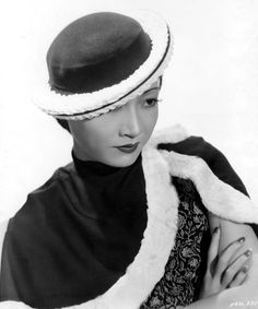"""The Breton sailor persists in popularity. Anna May Wong wears one in navy felt trimmed with white braid. The crown is shallow and the brim rolls.""  #vintage #hat #fashion"