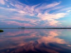 Photo of the Day: Clouds at sunrise mirrored in still waters