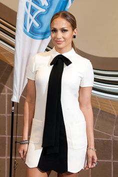 Jennifer Lopez arrived at American Idol auditions in New Orleans the 27th of August 2014 wearing a short dress from the Valentino Pre-Fall 2014/15 collection with a black panel down the front.