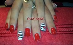 red manicure with kiss