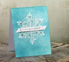 Love the layers, script background, tye dye like color, heat embossed snowflakes, rhinestones & banner. Gorgeous.
