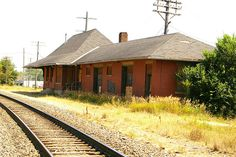 "Northfield, Minnesota depot built in 1889 by the Chicago, Milwaukee & St. Paul RR (later known as the Milwaukee Road). The depot was shared with the CRI&P (Rock Island Line). In 1969, passenger service with Rock's last Twin Star Rocket from Kansas City. The depot closed in 1982. ""Save the Northfield Depot"" was organized in 2010 to rescue and restore the historic building. They have succeeded, and it will soon be moved and restored. See http://www.northfielddepot.org/"