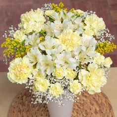 A beautiful bouquet featuring yellow Carnations, white Alstroemeria and sunny yellow Solidago.