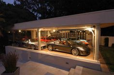 Luxury car garage 2 car garage right parking bay car auto li Luxury Sports Cars, Man Cave Garage, Garage House, Garage Shop, Garage Walls, Garage Doors, Küchen Design, House Design, Design Ideas