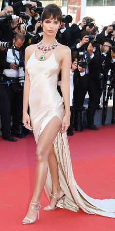 EMILY RATAJKOWSKI  -  The model and actress glittered at the premiere of Ismael's Ghosts in a champagne dress with a thigh-high slit and extensive train. Ratajkowski paired the simple silhouette with gleaming sandals and two layered Bulgari necklaces featuring an array of colorful jewels. -  Celebrity Looks from the 2017 Cannes Film Festival  -  May 19, 2017