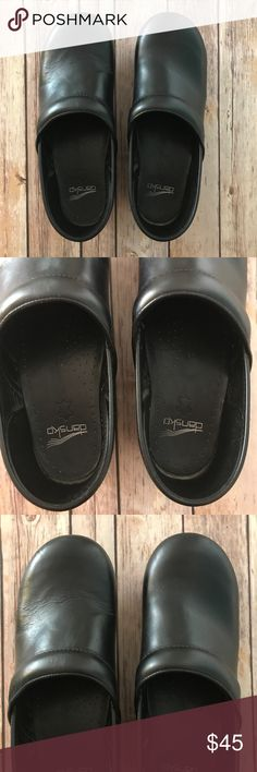 Black Dansko professional clogs size 41 Pre-loved and worn Dansko Professional black clogs. Size 41. Left clog has creasing across front as shown in pictures and both have mild scuff marks on toe. Please see photos. Good condition and these last for years. Great for those on their feet for many hours at a time and nurses or nursing students like myself! Dansko Shoes Mules & Clogs