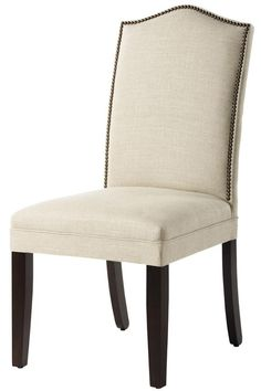 Parsons chair with nail head trim (as desk chair).  Comes in many fabric choices.  homedecorators.com