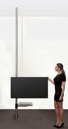 Contemporary TV ceiling mount / with holder for DVD player / floor-to-ceiling / swivel - FREISTEHEND TV HALTER ART129 - wissmann raumobjekte - Videos