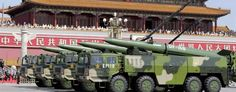Military vehicles carry DF-15B short-range ballistic missiles past the Tiananmen Gate in Beijing. (Jason Lee/Reuters)
