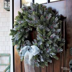 A small embellishment (like this gossamer bow) ties in frosted elements from your wreath. Choose a bow that connects with other colors on your porch, or use it as a statement piece that draws your eye to the door./