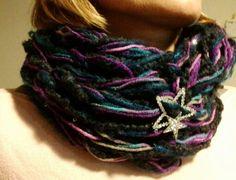 Arm knitting.stars om my scarf