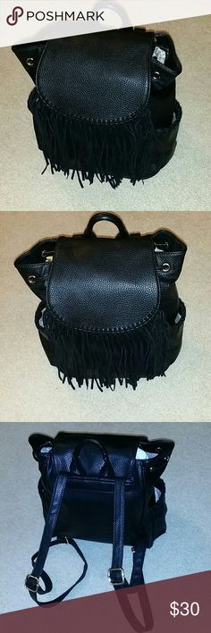 Leather Look Backpack With Fringes This beautiful leather look back pack is brand new, I've never used it!.  It's so fashionable with gold trim Bags Backpacks