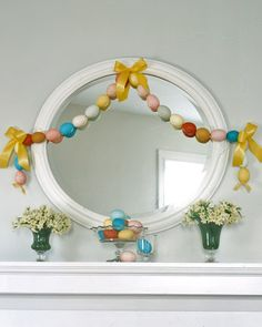Easter egg garland-original idea used blown out real eggs, but I would use plastic eggs, poke holes in each end of eggs with a hot nail and string like beads on ribbon or cord and then tie bows with satin or wire edged ribbon.