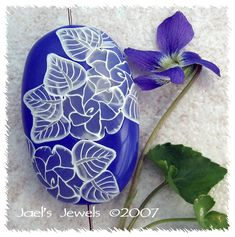 Transparent flower & leaf cane -Crystalline Roses by jaelsjewels