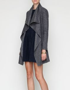 """Lightweight wool blend jacket with drape styling. Cascading draping at front, fitted sleeves. pockets at sides and silky thin inner lining.  Shell: 50% Wool, 50% Polyester Lining: 100% Polyester  18.5"""" pit to pit 13"""" shoulder to shoulder 33"""" should"""