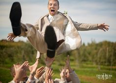 Lively groomsmen lead to fun photos!  Image by David Blair Photography.