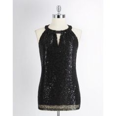 T Tahari Black Sequin Halter Top T Tahari black sequin halter top. Has v cut out in front. Silky round collar. 100% Polyester. Dry Clean. Silky interior and mesh sequin exterior. Some loose strings here and there from use but not noticeable. Very elegant and sparkles in the light. 2 clasp hooks on back collar. 42 in across. 28 in long. Has been in storage for a long time and will probably need to be dry cleaned after purchase. Will consider reasonable offers due to this. Tahari Tops Blouses