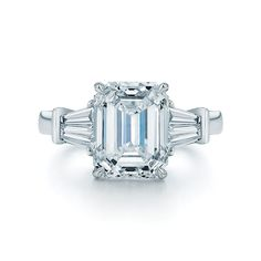 Emerald cut center stone engagement ring with 2 tapered baguettes on each side