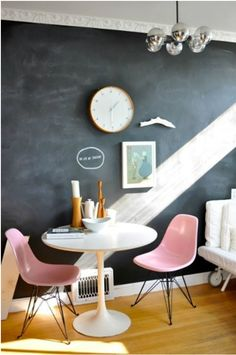 A chalkboard painted wall is such a cool idea - we love the contrast of the dark against the pastel pink Eames DSR Chair!