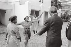 Nelson Mandela escaped the 'crushing crowd' in Cape Town on the day of his release 11 February 1990 by sneaking off for a quiet cup of tea. (iconic photo - 'Mandela, first encounter by George Hallett)