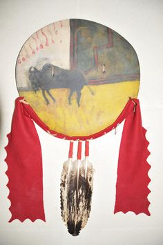 Crow (buffalo hide) war shield, with three immature bald eagle feathers-1870. Documented war trophy of Blackfoot warrior named to 'Broken hand' (family estate)