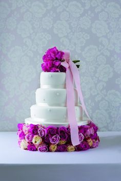 Decorate a plain white cake with gorgeous purple flowers. Cake from Marks