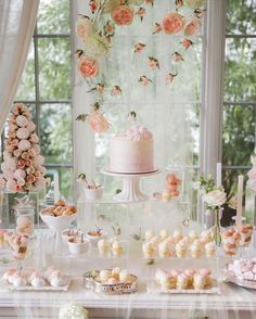Peach and blush wedding dessert table with macarons and rose backdrop // Beautiful pink and peach wedding inspiration