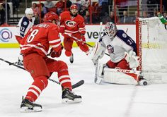 Carolina Hurricanes' Jay McClement (18) is blocked by Columbus Blue Jackets goalie Anton Forsberg (31), of Sweden, during the second period of an NHL hockey game in Raleigh, N.C., Tuesday, Jan. 10, 2017. (AP Photo/Gerry Broome)