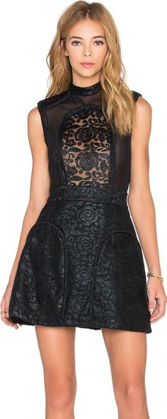 Devouring Lady Dress. Nylon blend. Dry clean only. Partially lined. Lace panel accent with rope trim detail. #Zhivago #Black #Dresses #Revolve Clothing #Women #fashion #obsessory #fashion #lifestyle #style #myobsession #lbd #littleblackdress #trend #lifestyle #luxury #fashionforwomen #women #blackdress #dress #shortdress