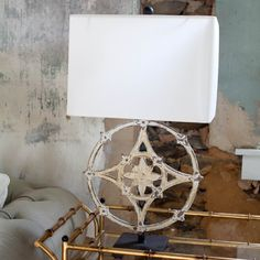 "Made of antique architectural iron elements, we love these custom Floral Compass Lamps. Sold individually. Dimensions: 28"" H x 6"" L x 15"" W Shade: 16''L x 11'"