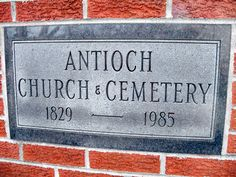 Antioch Cemetery - Sullivan, Indiana - At Antioch Cemetery, the apparition of a man in a dark suit holding flowers has been seen peering down at a grave on foggy nights at around 1:30 a.m. Visitors in cars also report shadow people flying over their cars and scratching or tapping on it.