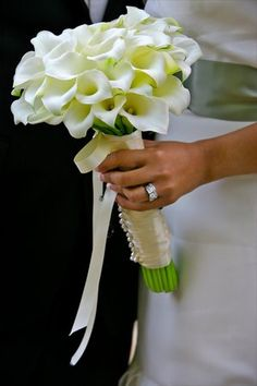 A beautiful bouquet of white mini-calla lilies. White mini-calla lilies are very versatile and can be blended with almost any color scheme - simply change the ribbon color to match the other colors in the wedding palette.