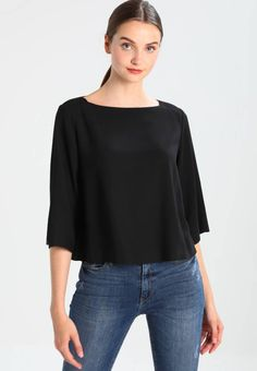 """Marc O'Polo. Blouse - black. Fit:large. Outer fabric material:98% viscose, 2% spandex. Our model's height:Our model is 70.0 """" tall and is wearing size 8. Pattern:plain. Care instructions:Dry clean only. Neckline:round neck. Le..."""