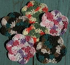 Create a garden of crochet flowers! Tiny Flower Scrubbies in cotton are handy kitchen accessories for washing dishes. Your kitchen will be in bloom this spring with these cute flowers.