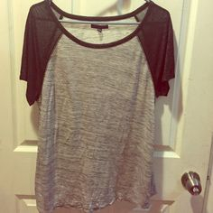 American Eagle Outfitters tee Grey top with black sparkly short sleeves size M. It is a loose fit. Brand new. American Eagle Outfitters Tops Tees - Short Sleeve