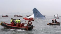 South Korean coast guard officers and rescue team members try to rescue passengers from the ferry Sewol on April 16, 2014. The ferry sank with 476 people aboard, mostly secondary school students. 295 died as the Sewol sank, leading to widespread anger and criticism of the actions of the crew, captain, owners, and government regulators. (AP Photo/Yonhap, Hyung Min-woo) | www.theyearthatwas.in #TheYearThatWas