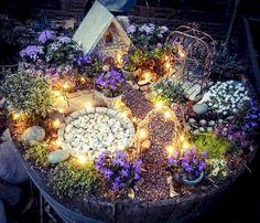 Beautiful diy fairy garden outdoor ideas (19)