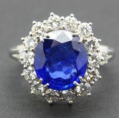 OnlineGalleries.com - Sapphire and Diamond Cluster Ring