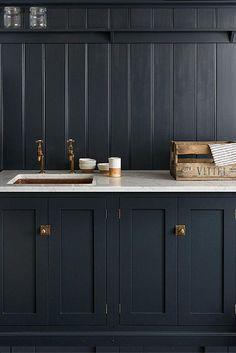 marble counterops and dark kitchen cabinetry and backsplash / sfgirlbybay