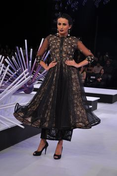 Black kalamkari lining kurta with a black lace skirt.